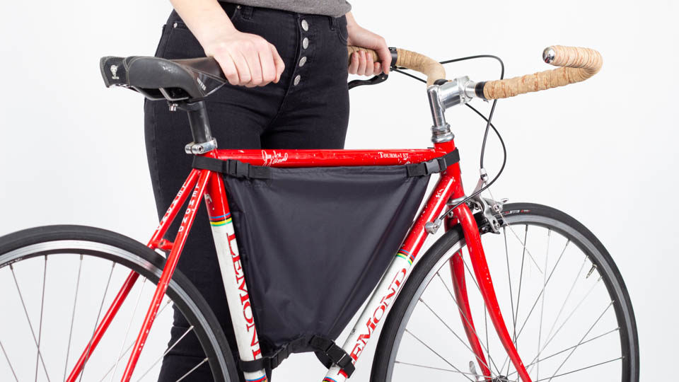 Woman with framepack bike bag installed on a 50cm bicycle
