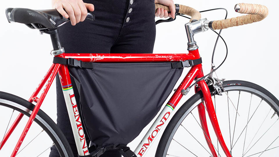woman with loaded framepack bike bag installed on a 50cm bicycle